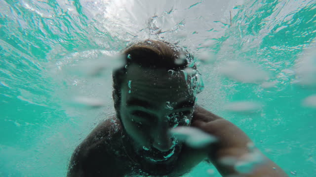 young man swimming in ocean - cancun stock videos & royalty-free footage