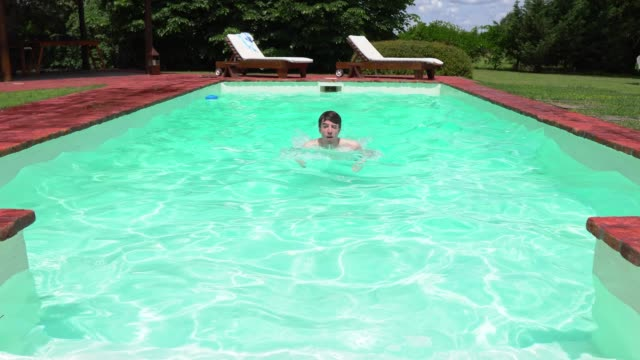 young man swimming in the pool - only young men stock videos & royalty-free footage