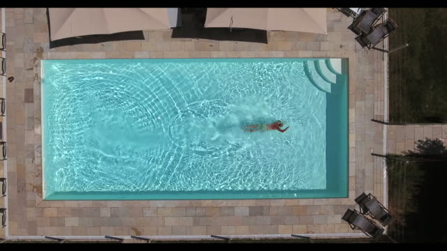 young man swimming - swimming pool stock videos & royalty-free footage
