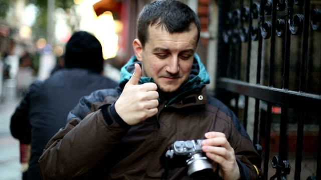 young man taking a picture - digital camera stock videos and b-roll footage