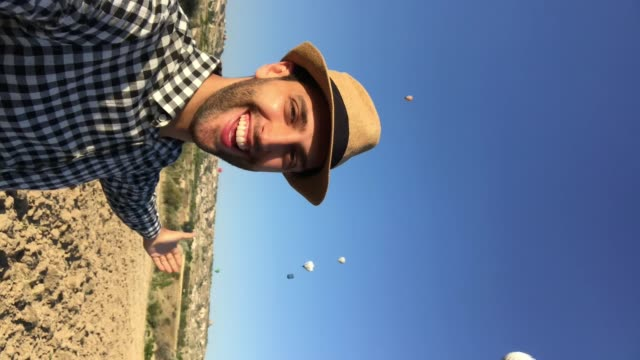 young man taking a selfie at cappadocia, turkey - famous place stock videos & royalty-free footage
