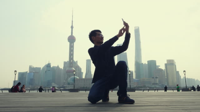 young man taking a selfie in shanghai - guy waving stock videos & royalty-free footage