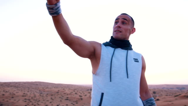 Young man taking a selfie in the desert