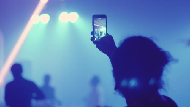 young man taking a video on concert - musician stock videos & royalty-free footage