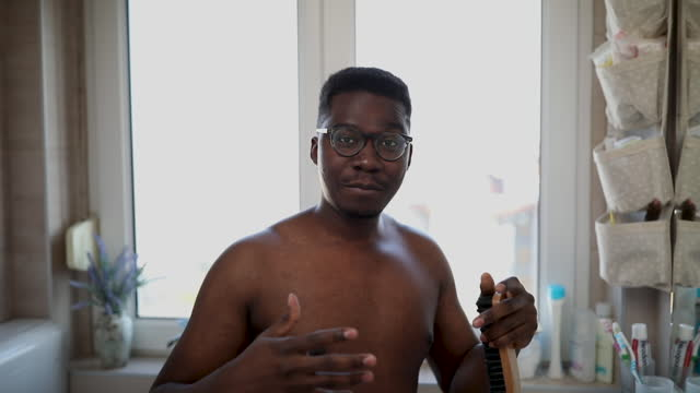 young man taking care of his body - hairbrush stock videos & royalty-free footage