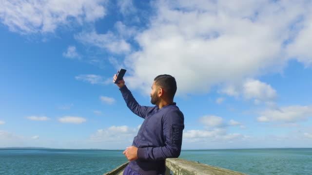 Young Man Taking Selfie Outdoor.