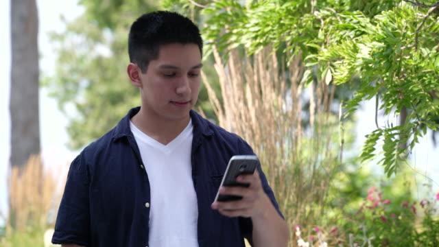 young man taking selfies on mobile phone. - lingua umana video stock e b–roll