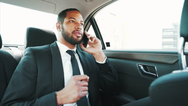 young man talking at mobile phone while traveling. - business talk stock videos & royalty-free footage