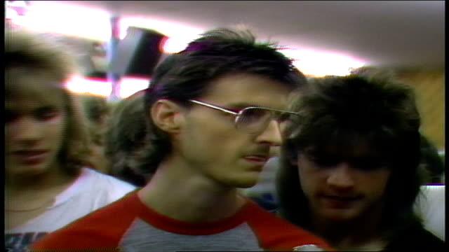 vídeos y material grabado en eventos de stock de young man talks about loving white snake and david coverdale in fridley minnesota - tienda de discos