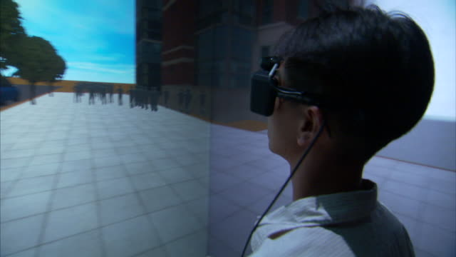 A young man tests  a simulated 3D environment.