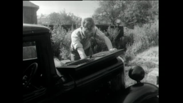 young man tinkers with car and tries to start it; 1955 - bonnet stock videos & royalty-free footage