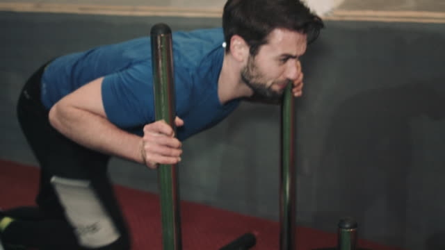 Young man training hard in bootcamp