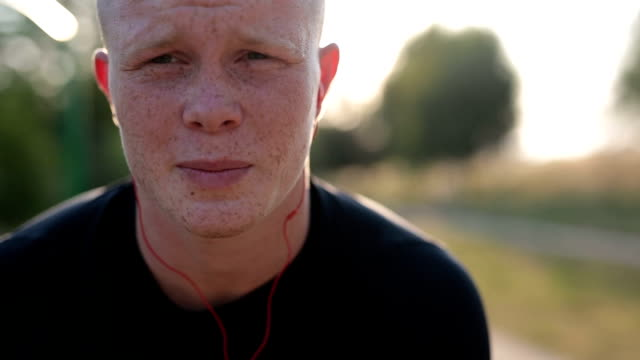young man training outdoors - freckle stock videos & royalty-free footage