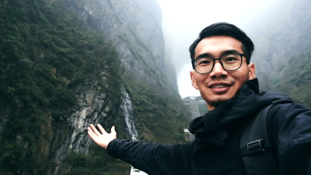 Young man travel in Tianmen mountain of Zhangjiajie, china