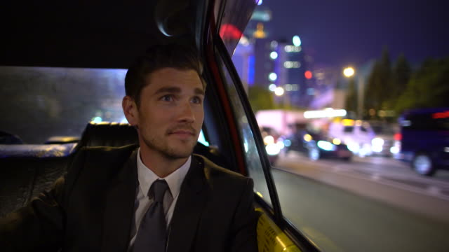 ms ts young man travelling in a car at night - junger mann allein stock-videos und b-roll-filmmaterial