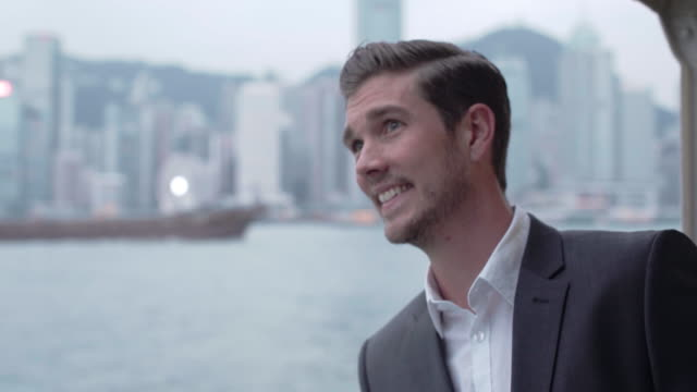 CU young man travelling on a ferry in Hong Kong