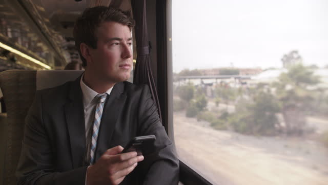 young man travelling on a train - full suit stock videos & royalty-free footage