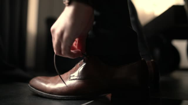 young man tying shoe laces close-up - fashion collection stock videos & royalty-free footage