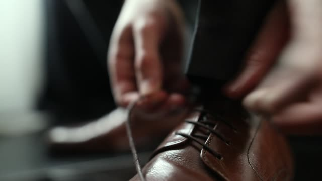 young man tying shoe laces close-up - tie stock videos & royalty-free footage