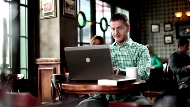 Young man typing at laptop