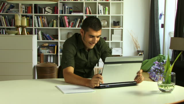 cu, young man using laptop - sideburn stock videos and b-roll footage