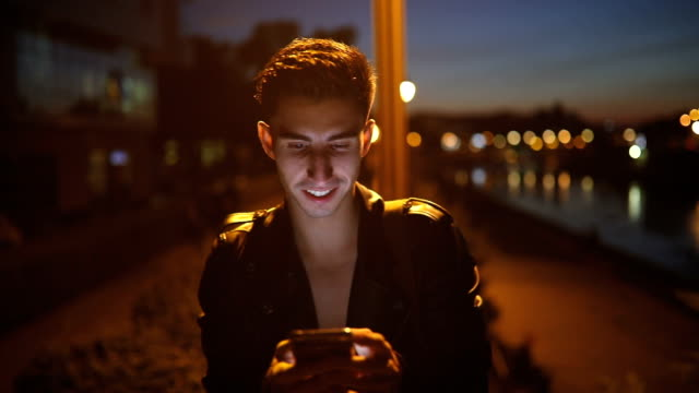 young man using phone in the night - cool attitude stock videos & royalty-free footage