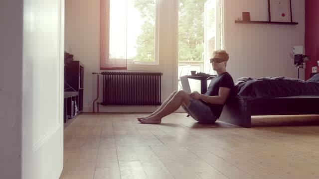 Young Man Using Virtual Reality Glasses