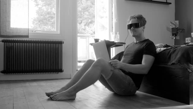 young man using virtual reality headset - grayscale stock videos and b-roll footage