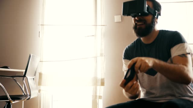 young man using vr - sensory perception stock videos & royalty-free footage