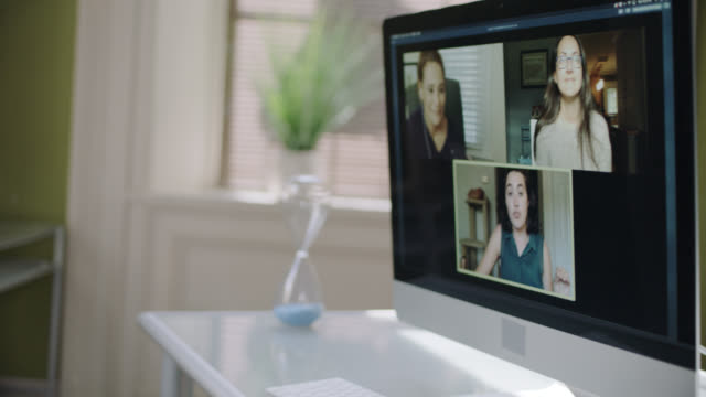 young man video conferencing with female coworkers - timer stock videos & royalty-free footage