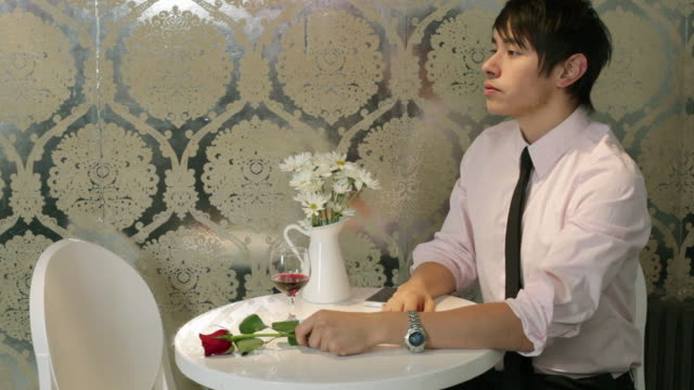 Young man waiting for date in cafe