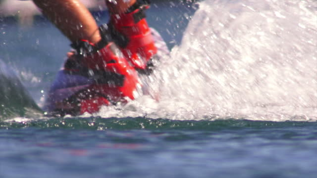 hd young man wakeboarding on lake slow motion - wakeboarding stock videos and b-roll footage