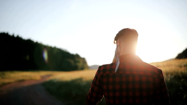 Young man walking on a hiking trail