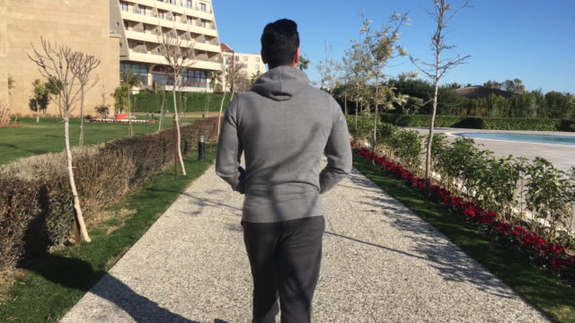 Young man walking on the path