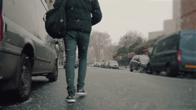 Young man walking on the street at winter