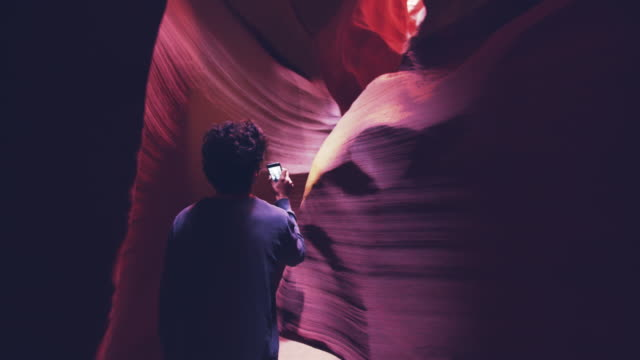 ws young man walking through antelope canyon - red rocks stock videos & royalty-free footage