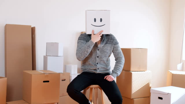Young man wear emoticon box on head