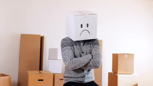 Young man wear emoticon box on head