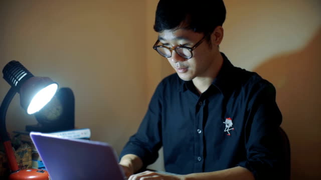 young man wearing glasses using a laptop - only young men stock videos & royalty-free footage