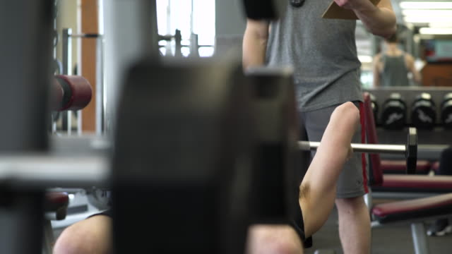 Young man weightlifting in a gym