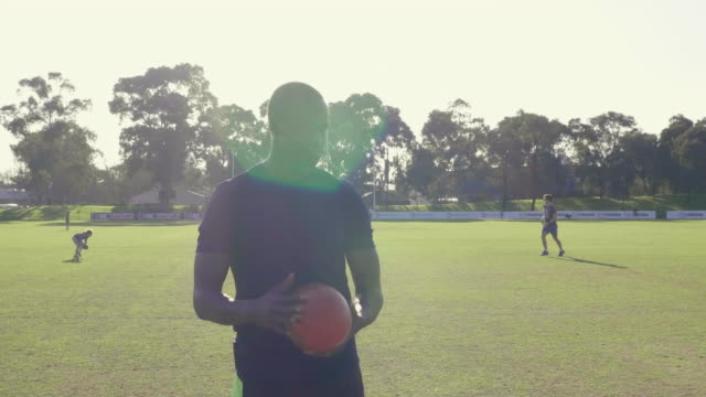 young man with ball on playing field - pitch stock videos & royalty-free footage