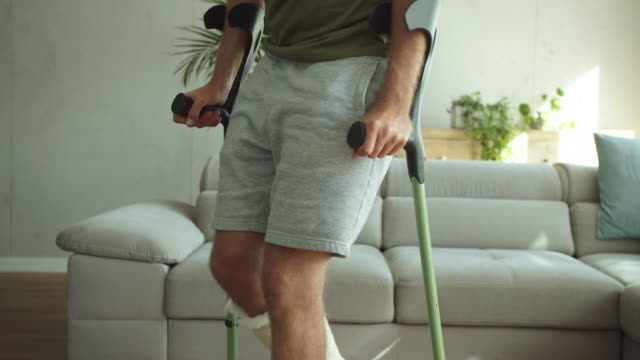 young man with broken leg at home - limb body part stock videos & royalty-free footage