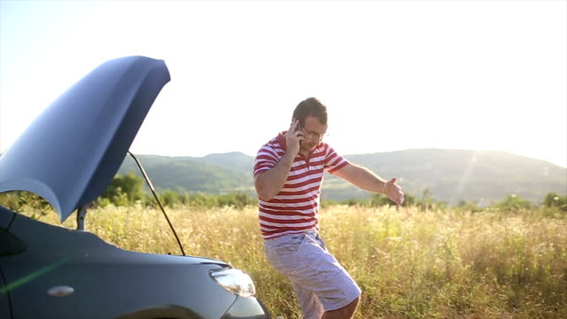 young man with car trouble - vehicle breakdown stock videos and b-roll footage