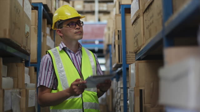 Young man with digital tablet in warehouse