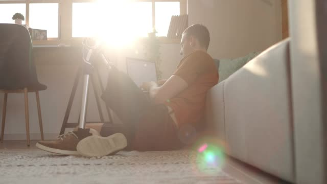 young man with disability using laptop at home - freelance work stock videos and b-roll footage