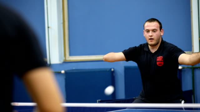 young man with one hand playing table tennis indoors - indoors stock videos & royalty-free footage