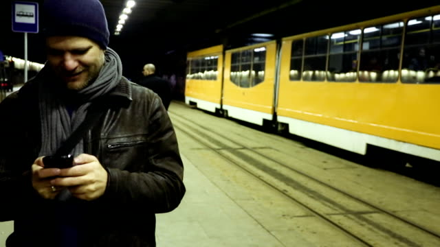 young man with smart phone and public transport - bulgaria stock videos & royalty-free footage