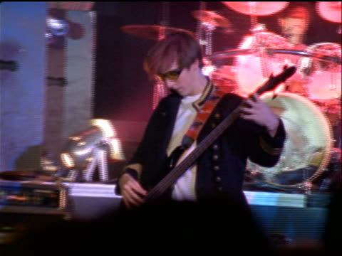 young man with sunglasses playing electric guitar on stage in rock concert - pop musician stock videos and b-roll footage