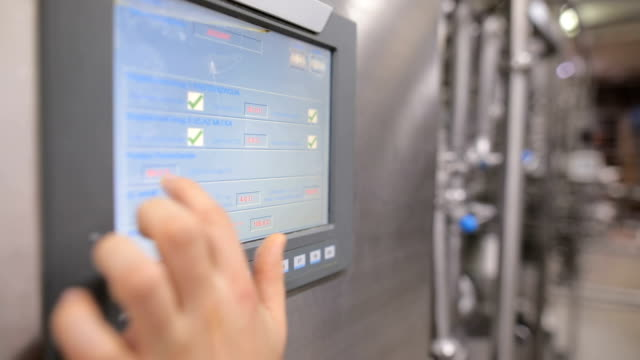 young man working at a food factory on the control station.hand on the touch screen - control stock videos & royalty-free footage