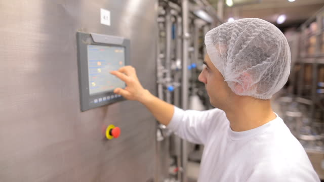 young man working at a food factory on the control station.hand on the touch screen - food processing plant stock videos & royalty-free footage
